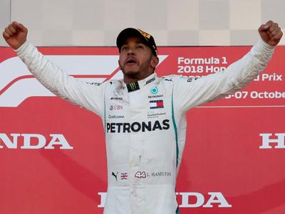 Hamilton triunfa en Japón y queda cerca del campeonato