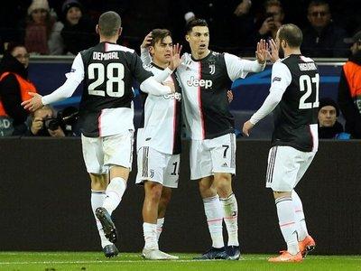 Cristiano e Higuaín envían a Juventus a octavos con récord de puntos