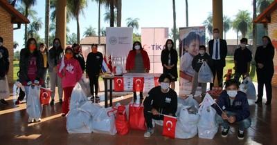 Ropas, calzados y juguetes son donados a albergues del Minna