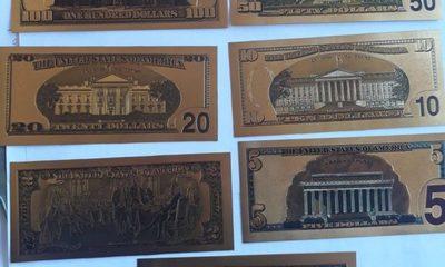 Retienen a abogado con impresiones de billetes de dólares