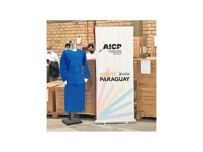 Confeccionistas ya visten  al personal de Salud con batas made in Paraguay