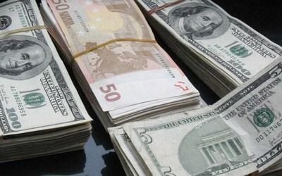 El peso mexicano aguanta la volatilidad y cierra en 20,41 unidades por dólar