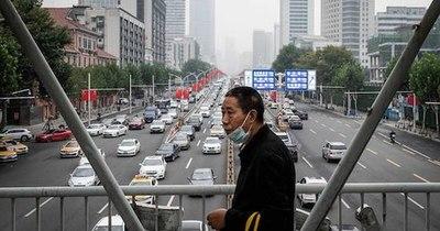 La Nación / China afirma que continúan negociaciones con la OMS por investigación sobre COVID-19