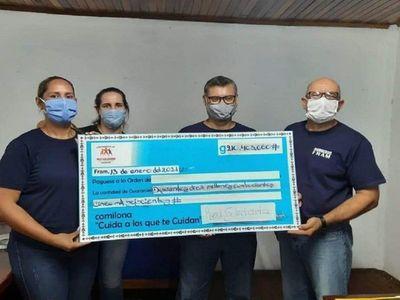 Bomberos de Fram reciben G. 210 millones recaudados en Gran Comilona Solidaria