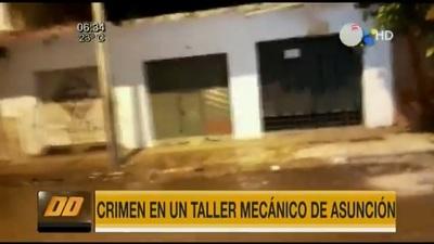 Investigan asesinato de joven en un taller mecánico