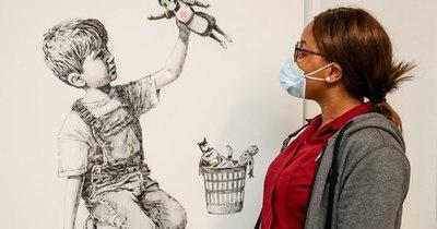 La Nación / Subasta de Banksy recauda 23 millones de dólares para sanidad británica