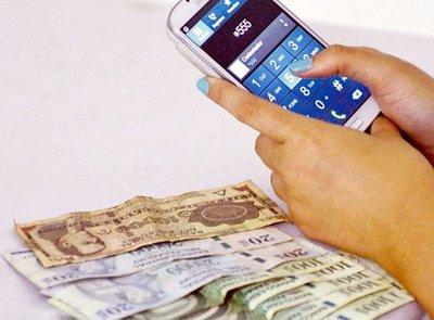 Pulseada entre banqueros y telefónicas en negocio de giros