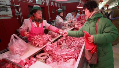 China pretende estabilizar producción y precios de cerdo con reservas