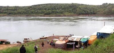 Asesinan a joven de un disparo en la cabeza cuando cruzaba el río Paraná