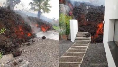 Lava ardiendo llega a casas en La Palma