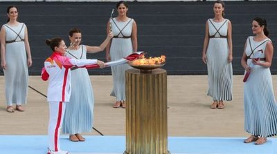 Grecia entrega la antorcha olímpica para los JJOO de Invierno de Pekín
